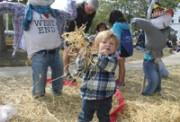 little kid throwing hay_6648