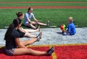 Ocean Township High School student volunteers play ball with Schroth School student.