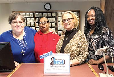 Lisa Kelly photo Janet Birckhead, Henrietta Dawson, Janice Grace and Cadene Patterson love to talk books at the library!