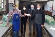 Dominique Perez, Program Supervisor at St. Bridgid's Pantry & Kitchen receives donation from RCGLB President G. Heggie.
