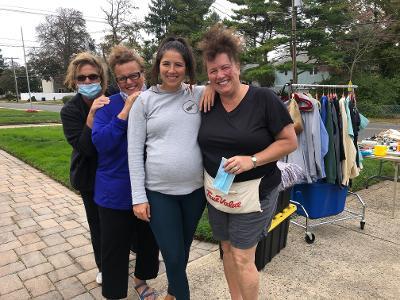 Holding a yard sale during Long Branch's yard sale weekend, are Paula Minnisch, Debbie Parnell, Jill Siciliano, and Joann Ceravolo.